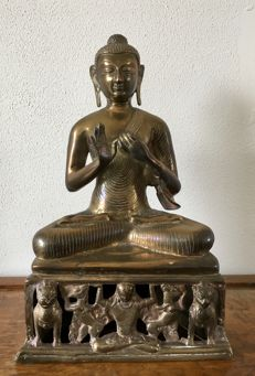 Large seated Buddha teaching mudra - Himalayas - second half 20th century.