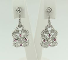 14 kt white gold dangle earrings set with 8 brilliant cut rubies of 0.10 carat, and 68 brilliant cut diamonds of 0.90 carat, height 3.0 cm, width 1.3 cm