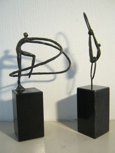 "Corry Ammerlaan van Niekerk - lot of two sculptures of  gymnasts - including ""geen schakel kan ontbreken"" (no link can be missing)"
