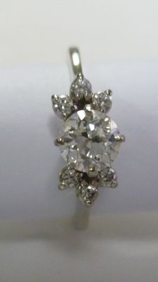 Ring in 18 kt white gold with brilliant cut central diamond of 0.52 ct.  (G/VS2) and six of 0.11 ct. (G/VVS). IGE certificate.