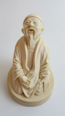 Ivory  carving of a old man - China - late 19th century