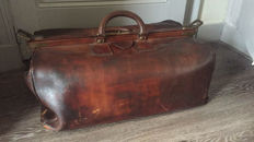 A large leather travel bag - marked Haagsche suitcase factory, first half 20th century