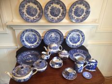 24 pottery pieces of various tableware with blue and white transfer print decorations, Holland and England, circa 1850