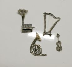 Lot of four miniature musical instruments in silver