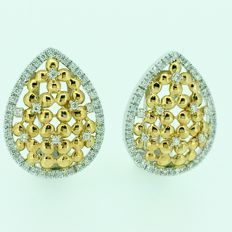 White and yellow gold earrings with diamonds.