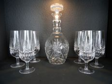 Cut set with six crystal glasses on base and heavy decanter