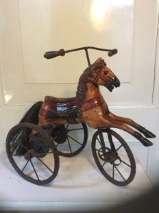 Very decorative wooden tricycle horse