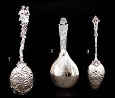 Three large silver spoons