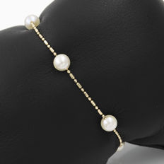 18 kt gold - bracelet - cultured pearls - length 17.5cm (approx.).