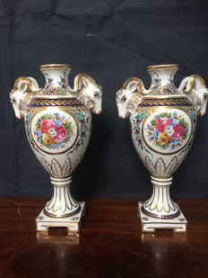 Two vases with buck's heads in Sevres style