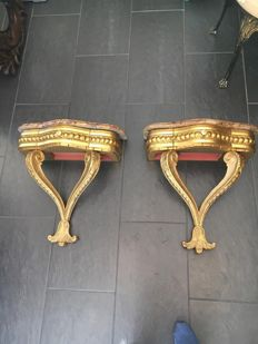 Pair of gilded console tables with marble stone