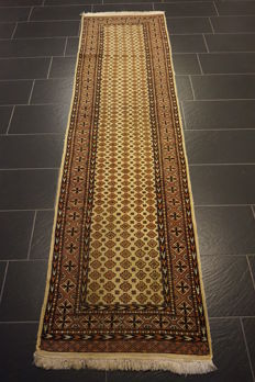 Magnificent hand-knotted Oriental carpet Buchara Jomut Kazak pattern, runner 80 x 300 cm. Made in Pakistan, mid of the 20th century.