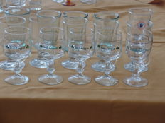 Lot of fifteen cut glasses including Irish Coffee, Rhum Negrita and Bacardi.
