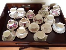 Fifteen English cups and saucers, among which Royal Windsor and Cambridge Garden, Fine Bone and Bone China