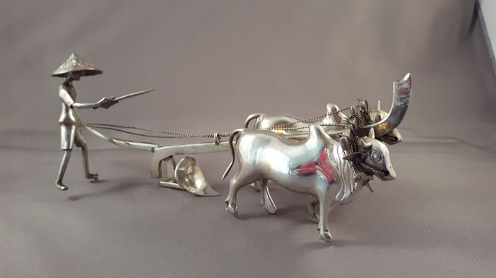 Djokja silver plow with buffaloes