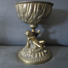Heavy Cup or chalice.