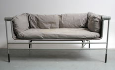 Unknown designer, extremely rare foldable sofa with grey painted steel frame, seat in stretched canvas with loose cushions