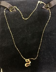 18 kt gold necklace with Dodo pendant in 18 kt gold.