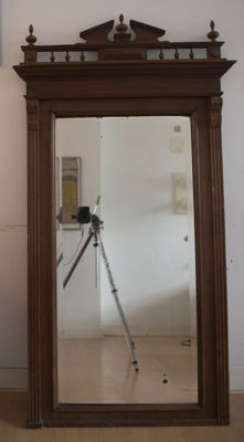 A beautiful mirror framed with a wooden frame, early 20th century