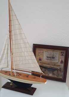 Wooden sailing yacht and nautical diorama