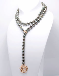Long Tahitian 8x11 mm Pearl necklace featuring a Gold Flower Clasp