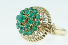 14 karat gold princess/entourage ring set with many emeralds, ring size 16.25