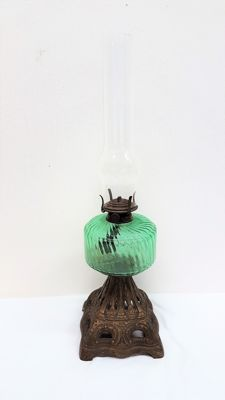 Oil lamp green glass with cast iron base, first half 20th century, the Netherlands