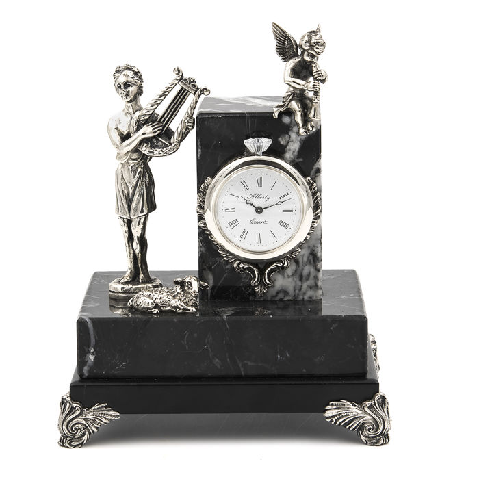 Alberty figure/clock in sterling silver depicting a shepherding scene playing musical instruments, finished on a marble pedestal