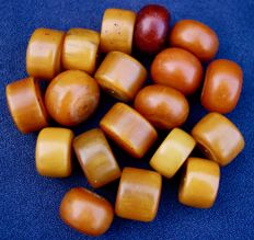 "Eighteen large antique beads in ""African amber"" or phenolic resin. North Africa, beginning of the 20th century."