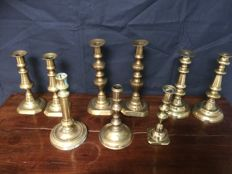Nine brass pin candlestick, including three sets - circa 1900