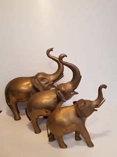 Three large brass elephants