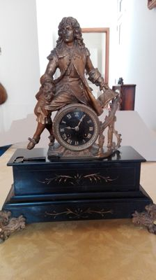 Black marble clock – 1850, France – with statue in full bronze