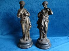 Patinated classic statues of women