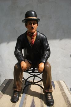 Charlie Chaplin in resin and metal chair