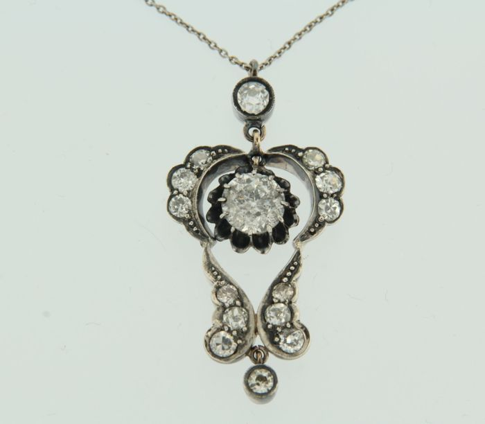 Silver necklace, with a pendant made of gold and silver, set with Bolshevik cut diamonds, necklace is 43 cm long.
