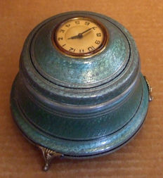 Musical powder box with clock