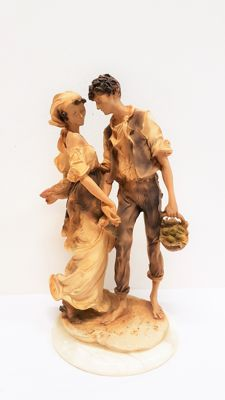 Biscuit earthenware statue man / woman on marble plinth