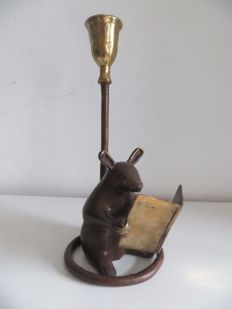 Bronze candlestick of a reading mouse with his tail as the candle holder