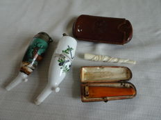 5 pieces of antique smoking articles. Including pipe bowls, cigarette holders, cigar case and amber cigarette with gold.