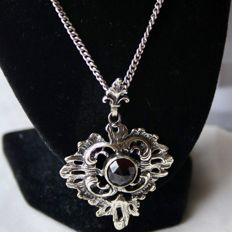 Handcrafted extra large pendant ca. 1900 with Bohemian facetted old cut Garnet approx. 8,8mm + solid old silver heavy chain.