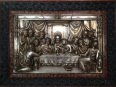 """The Holy Supper"" in brass plated relief."