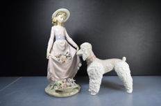 Lladro - Two porcelain sculptures 'woman with flowers' and 'poodle'