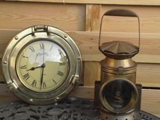 Brass ship's clock and copper partridge lantern.