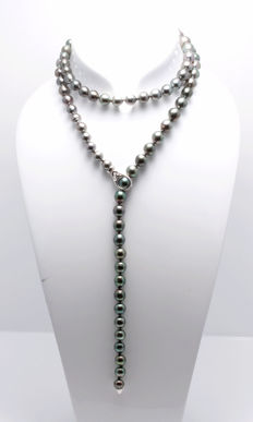 Long Tahitian Pearl necklace  8x10.5 mm featuring a Gold and Diamond Adjustable Clasp