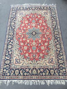 Handmade ancient Persian fine Ispahan carpet measuring 112 x 165 cm.