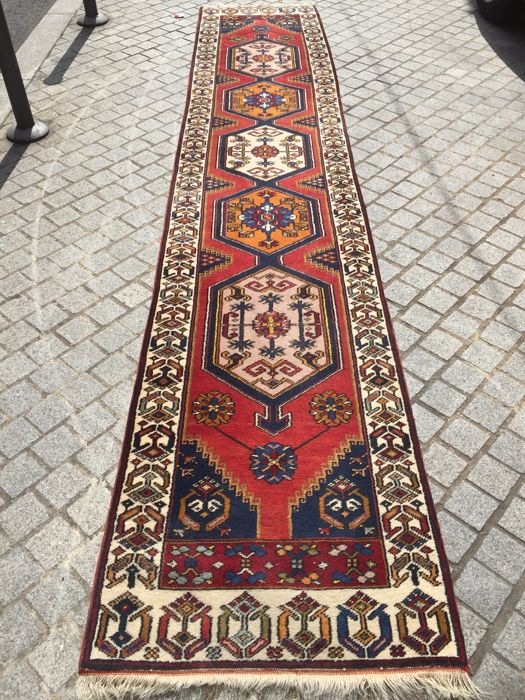 Handmade antique Turkish Anatolian hall carpet measuring 77 x 400 cm.