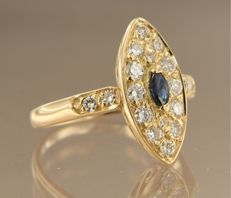 18 kt yellow gold ring with a central marquise-cut sapphire with 18 brilliant-cut diamonds in entourage, ring size 17.5 (55)