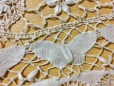 Lot of 9 spring doilies with 68 butterflies in a meadow of flowers, 1920-40, Northern Italy