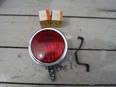 A used HELLA REAR FOG LIGHT with a diameter of 130 mm from the 1960s and 1970s