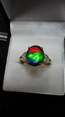 Very Rare, Genuine Canadian Fossil AA grade Ammolite gold Coctail ring. Stunning natural colours.